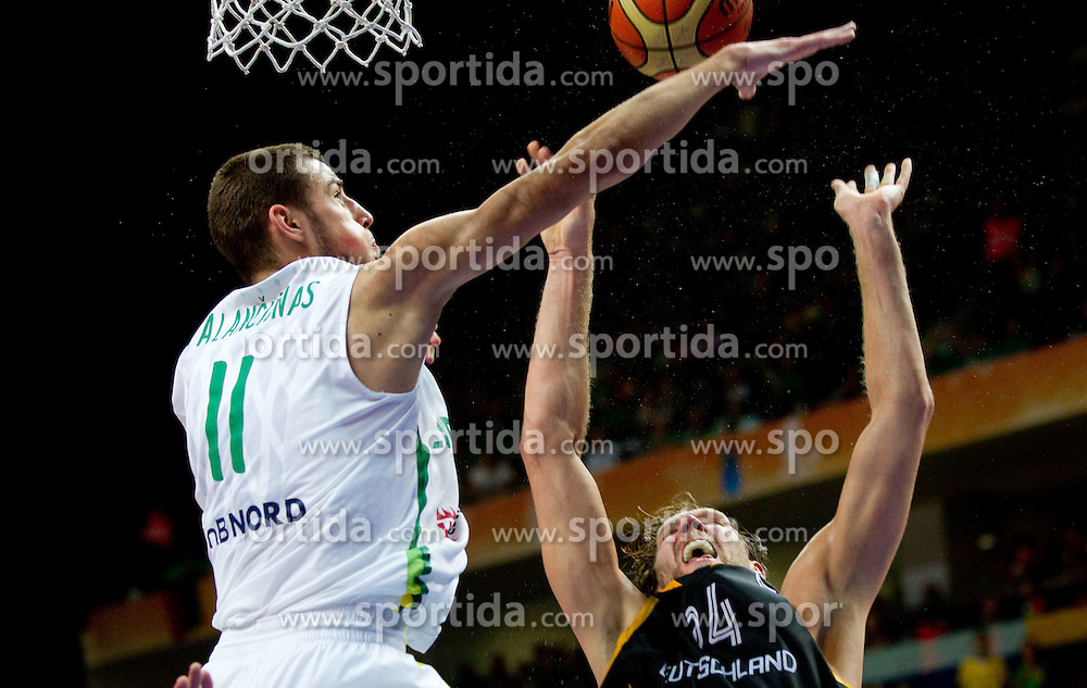 Jonas Valanciunas of Lithuania vs Dirk Nowitzki of Germany during basketball game between National basketball teams of Lithuania and Germany at FIBA Europe Eurobasket Lithuania 2011, on September 11, 2011, in Siemens Arena,  Vilnius, Lithuania. Lithuania defeaed Germany 84-75. (Photo by Vid Ponikvar / Sportida)