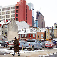 A man walks through center city Philadelphia, PA January 10, 2017.