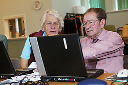 Man and woman  at an over 60s computer training class; the Sybil Levin Centre; Age Concern; Nottingham,