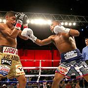 Jonathan Gonzalez (R) lands a shot the head of Richard Rodriguez during a Telemundo boxing match between at Osceola Heritage Park on Friday, February 23, 2018 in Kissimmee, Florida.  (Alex Menendez via AP)
