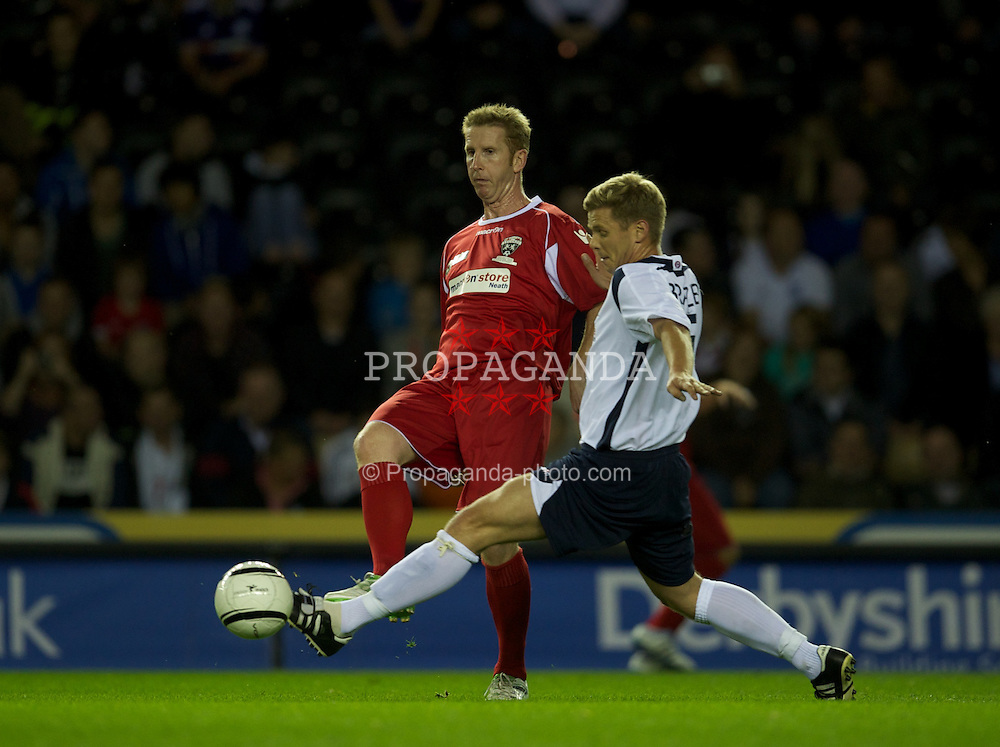 DERBY, ENGLAND - Thursday, September 8, 2011: Wales' Iwan Roberts in action against England's Jeff Brazier during a legends match at Pride Park. (Pic by David Rawcliffe/Propaganda)