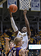 WICHITA, KS - JANUARY 05:  Forward Cleanthony Early #11 of the Wichita State Shockers drives to the basket against the Northern Iowa Panthers during the first half on January 5, 2014 at Charles Koch Arena in Wichita, Kansas.  Wichita State defeated Northern Iowa 67-53. (Photo by Peter Aiken/Getty Images) *** Local Caption *** Cleanthony Early