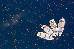 Aerial view of rowing boats on Loch Faskally in autumn , Pitlochry, Perthshire, Scotland, UK
