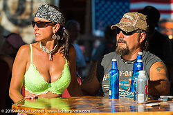 Melissa and Steve Roberson at the Full Throttle Saloon during the annual Sturgis Black Hills Motorcycle Rally. SD, USA. August 7, 2014.  Photography ©2014 Michael Lichter.