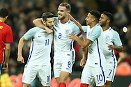 GOAL - Adam Lallana of England  (l) celebrates after scoring his sides 1st goal from a penalty with Jordan Henderson, the England captain, Raheem Sterling of England and Raheem Sterling of England. England v Spain, Football international friendly at Wembley Stadium in London on Tuesday 15th November 2016.<br /> pic by John Patrick Fletcher, Andrew Orchard sports photography.