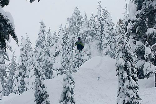 Young man skiing at Kirkwood ski resort near Lake Tahoe, CA.