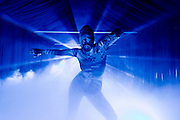 Exotic dancer in blue