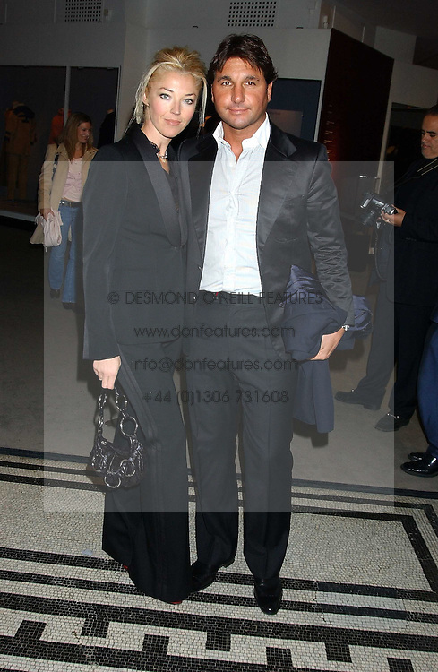 MISS TAMARA BECKWITH and MR GEORGE VERONI at a fashion show and after party to celebrate the 20th Anniversay of fashion designer Ozwald Boateng held at the Victoria & Albert Museum, London on 25th November 2005.<br />
