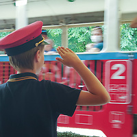 Child works at a train station at the Children's Railway in Budapest, Hungary on Aug. 26, 2020. ATTILA VOLGYI
