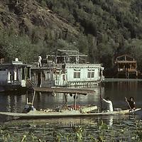 Tourist houseboats and floating vendors in Shikara (boat), Srinigar, Kashmir, India.