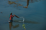 Woman fishing with baskets<br /> Assam<br /> North East India<br /> UNESCO World Heritage Site