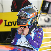 Darrell Wallace Jr. preps himself during practice for the 60th Annual NASCAR Daytona 500 auto race at Daytona International Speedway on Friday, February 16, 2018 in Daytona Beach, Florida.  (Alex Menendez via AP)