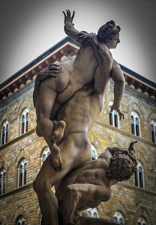 """The Rape of the Sabine Woman  Statue in Florence, Italy. The sculpture is based on a legend of early Roman history. The term """"rape"""" does not necessarily mean sexual violation. The men of Rome abducted neighboring women to populate their city."""