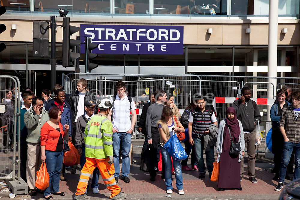 Scene outside the Stratford Centre in East London. People crossing the road outside this shopping complex. This is a relatively poor area of London, but in recent years has seen much regeneration, the construction of a major transport hub and various shopping complexes. Stratford is adjacent to the London Olympic Park and is currently experiencing regeneration and expansion linked to the 2012 Summer Olympics. (Photo by Mike Kemp/For The Washington Post)