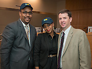 Dr. Andrew Houlihan, right, recognizes Holland Middle School principal Tarrynce Robinson, left, and Thomas Middle School principal Khalilah Campbell-Rhone, center, during a principal meeting, April 9, 2014.