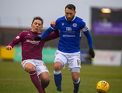 Arbroath's Ricky Little and Queen of the South's Stephen Dobbie. Arbroath 2 v 0 Queen of the South, Scottish Championship game played 15/2/2020 at Arbroath's home ground, Gayfield Park.