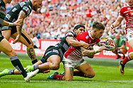 Wigan Warriors centre Oliver Gildart (4) scores a try to make the score 16-14 during the Ladbrokes Challenge Cup Final 2017 match between Hull RFC and Wigan Warriors at Wembley Stadium, London, England on 26 August 2017. Photo by Simon Davies.