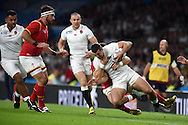Jonny May of England is tackled by Gareth Davies of Wales. Rugby World Cup 2015 pool A match, England v Wales at Twickenham Stadium in London, England  on Saturday 26th September 2015.<br /> pic by  Andrew Orchard, Andrew Orchard sports photography.