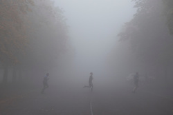 © Licensed to London News Pictures. 09/10/2021. London, UK. Member son the public exercise during heavy fog in Greenwich Park in South East London. A yellow weather warning for fog is in place in parts of London and South East England.  Photo credit: George Cracknell Wright/LNP