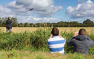 Members of the public watch Spitfires and other World War II aircraft take of from Goodwood airfield near Chichester as the country marked the 75th anniversary of the Battle of Britain. <br /> Picture date Tuesday 15th September, 2015.<br /> Picture by Christopher Ison. Contact +447544 044177 chris@christopherison.com