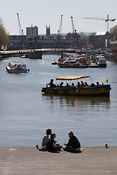 © Licensed to London News Pictures. 21/04/2015. Bristol, Avon, UK. People enjoying the warm weather in the city centre of Bristol today, 21st April 2015. The south west of England is set for more warm temperatures and plenty of sunshine today. Photo credit : Rob Arnold/LNP