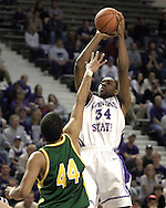 Kansas State guard Akeem Wright (34) fires a shot over North Dakota State forward Andre Smith (44) during the second half of K-State's 82-56 win over North Dakota State at Bramlage Coliseum in Manhattan, Kansas, January 2, 2006.