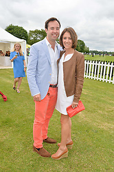 JAMIE MURRAY-WELLS and LOTTIE FRY at the Cartier Queen's Cup Final polo held at Guards Polo Club, Smith's Lawn, Windsor Great Park, Egham, Surrey on 15th June 2014.