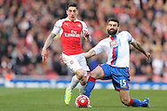 Héctor Bellerín of Arsenal gets away from Mile Jedinak, the Crystal Palace captain. Barclays Premier league match, Arsenal v Crystal Palace at the Emirates Stadium in London on Sunday 17th April 2016.<br /> pic by John Patrick Fletcher, Andrew Orchard sports photography.