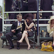 Race goers relax before the start of the races at Royal Ascot Race Course. Royal Ascot is one of the most famous race meetings in the world, frequented by Royalty and punters from the high end of society to the normal everyday working class. Royal Ascot 2009, Ascot, UK, on Wednesday, June 17, 2009. Photo Tim Clayton..