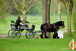 © Licensed to London News Pictures. 19/04/2016. Windsor, UK. Prince Philip, Duke of Edinburgh out riding a carriage in the Grounds of Windsor Castle on the week that Queen Elizabeth II is due to celebrate her 90th birthday. The duke is currently 94 years old.  . Photo credit: Ben Cawthra/LNP