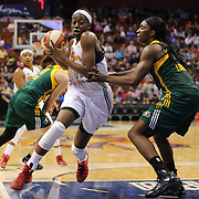 Chiney Ogwumike, (left),  Connecticut Sun, drives to the basket past Crystal Langhorne, Seattle Storm, during the Connecticut Sun Vs Seattle Storm WNBA regular season game at Mohegan Sun Arena, Uncasville, Connecticut, USA. 23rd May 2014. Photo Tim Clayton