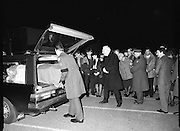 Irish Soldiers Bodies Returned From Lebanon. (R99)..1989..24.03.1989..03.24.1989..24th March 1989..While serving on the peacekeeping mission with the UN three Irish soldiers lost their lives when the vehicle they were in struck a land mine. The mine had ben planted by a Hezbollah Group who were targeting the Israeli military. The Soldiers; Corp Fintan Heneghan, Pte Mannix Armstrong and Pte Thomas Walshe were serving with C Company, 64th Infantry Batallion in Brashit, Sth Lebanon...Picture shows the coffin of Pte Thomas Walshe of Tubbercurry,Co Sligo being placed into the hearse as his grieving family stand alongside.