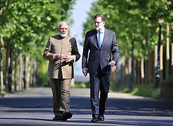 May 31, 2017 - Madrid, Spain - Indian Prime Minister Narendra Modi, left, walks with Spanish President Mariano Rajoy at La Moncloa Palace May 31, 2017 in Madrid, Spain. Modi is on a four-day overseas trip through Europe. (Credit Image: © Lalit Kumar/Planet Pix via ZUMA Wire)