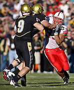 SHOT 11/27/09 3:28:11 PM - Nebraska Cornhuskers defensive tackle Ndamukong Suh (#93) goes after Colorado quarterback Tyler Hansen (#9) during the first half of their game at Folsom Field in Boulder, Co. Nebraska won the game 28-20. Suh is one of the top players in the nation, a candidate for the Heisman trophy and a likely top NFL draft pick. (Photo by Marc Piscotty / © 2009)