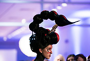 """Model Amanda Acker displays the """"Scorpius Antares"""" hair sculpture during """"Hair Affair: The Art of Hair"""" at Madison Museum of Contemporary Art in Madison, WI on Thursday, April 25, 2019. The sixth biennial brought an array of designers and stylists from across Wisconsin to create under the theme of """"Zodiac."""""""