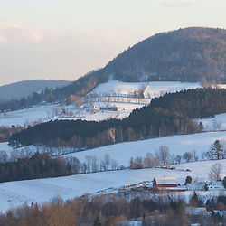 The view of the surrounding farms from downtown Peacham, Vermont in winter.