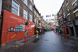© Licensed to London News Pictures. 21/12/2020. LONDON, UK. A quiet Chinatown in the West End as Tier 4, Stay at Home, alert level restrictions are imposed on much of the UK to combat the ongoing coronavirus pandemic in the light of a recently discovered mutant strain that was discovered in the south east of England.  Photo credit: Stephen Chung/LNP