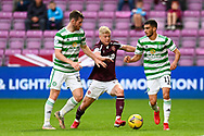 Alex Cochrane (#17) of Heart of Midlothian FC tries to get between Anthony Ralston (#56) of Celtic FC and Liel Abada (#11) of Celtic FC during the Cinch SPFL Premiership match between Heart of Midlothian FC and Celtic FC at Tynecastle Park, Edinburgh, Scotland on 31 July 2021.