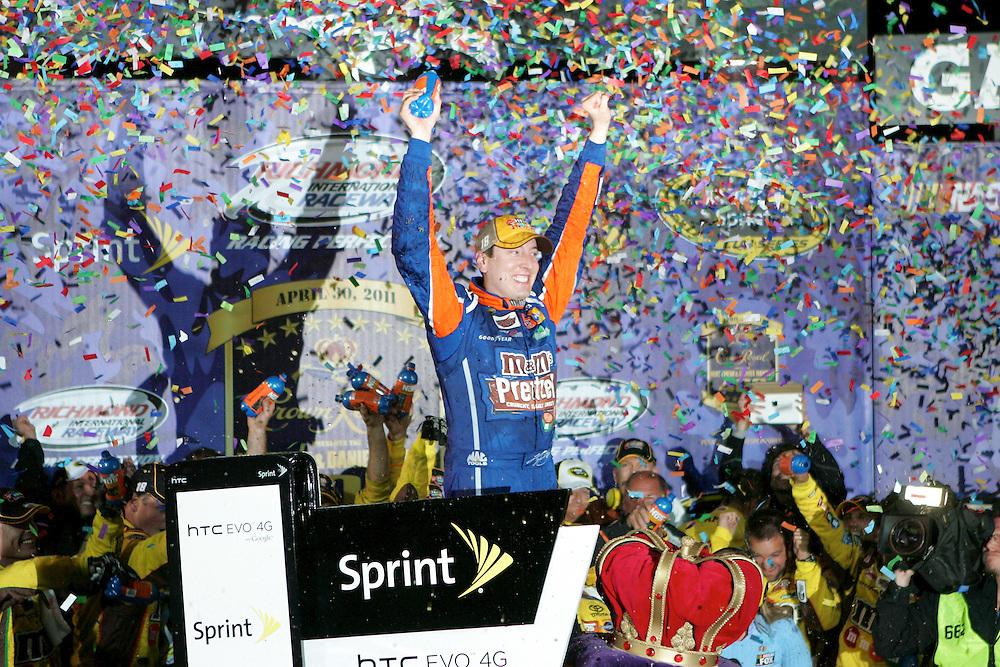 Apr 30, 2011; Richmond, VA, USA; NASCAR Sprint Cup Series driver Kyle Busch celebrates winning the Matthew and Daniel Hansen 400 at Richmond International Raceway. Mandatory Credit: Peter Casey-US PRESSWIRE