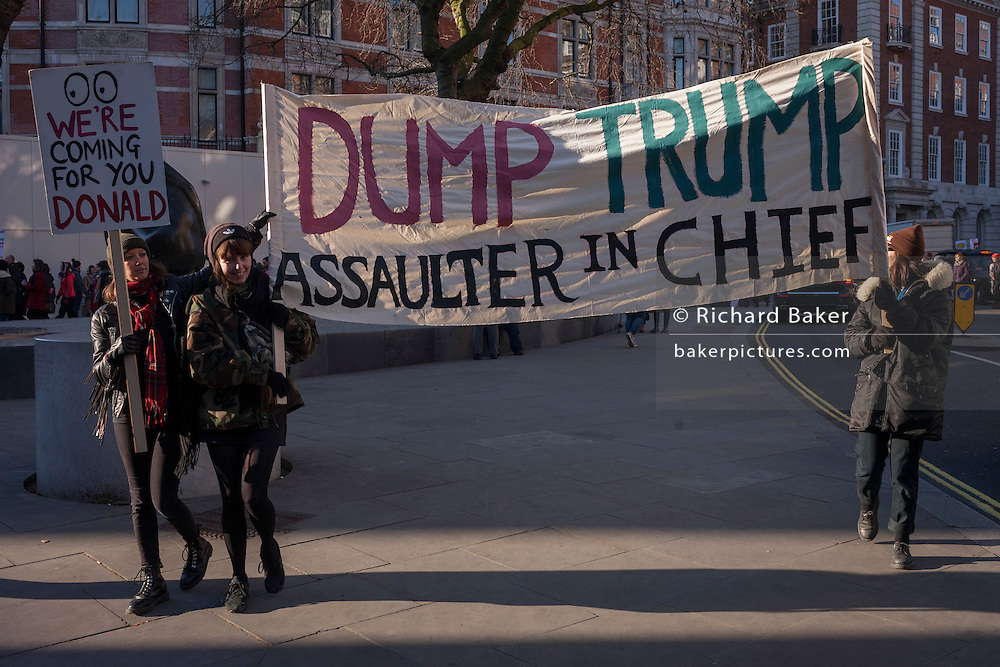 Women protesters march through central London as part of an international campaign on the first full day of Donald Trump's presidency, on 21st January 2017, in London, England. They marched from the US embassy in Mayfair, to Trafalgar Square for a rally, held in solidarity with a march in Washington and other cities around the world. Organisers say it highlighted women's rights, which they perceive to be under threat from the new US administration. London organisers announced on stage that between 80,000 and 100,000 people - which included both men and women - had taken part in the rally.