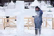 Moscow, Russia, 18/01/2016.<br /> An Emergency Situations worker carves an ice cross on a frozen lake in preparation for Orthodox Christian believers celebrating Epiphany in southern Moscow. Priests blessed the waters and followers baptised themselves by total immersion in the freezing lake in temperatures of minus 11C.