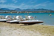 Pedalos people swimming sandy beach, island of  Ibiza, Balearic Islands, Spain, 1950s