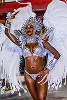 Samba dancer in the Carnaval parade of Unidos do Porto da Pedra samba school in the Sambadrome, Rio de Janeiro, Brazil.