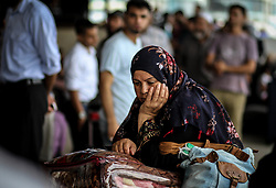 August 16, 2017 - Rafah, Gaza Strip, Occupied Palestinian Territory - A Palestinian waits for permission to enter Egypt as people gather at the Rafah border crossing in the southern Gaza Strip after the Egyptian authorities allowed the Rafah crossing to open for two days in both directions for humanitarian and outstanding cases, In Rafah in southern Gaza Strip. (Credit Image: © Ahmad Salem via ZUMA Wire)