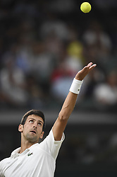 LONDON, July 14, 2018  Novak Djokovic of Serbia serves during the men's singles semifinal match against Rafael Nadal of Spain at the Wimbledon Championships 2018 in London, Britain, on July 13, 2018. The match was suspended due to the time issue. (Credit Image: © Stephen Chung/Xinhua via ZUMA Wire)