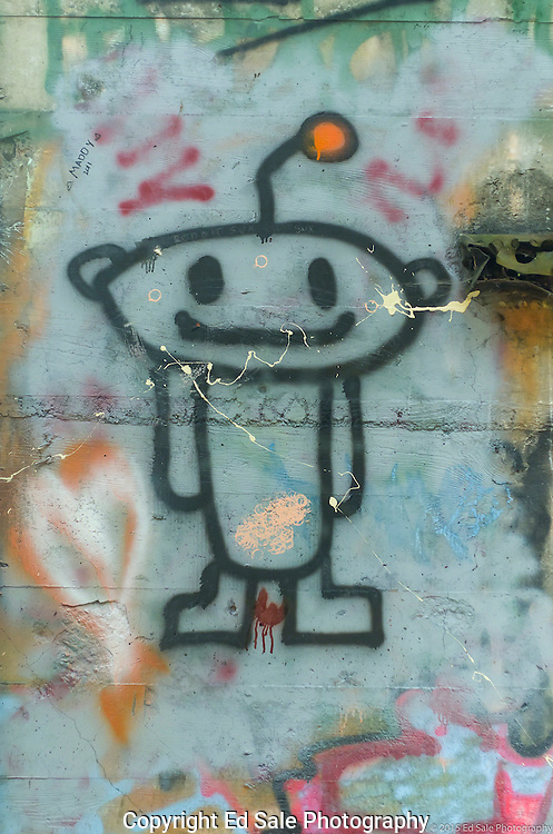 Street art painting in old mill building in Vernonia, Oregon depicts a friendly space alien