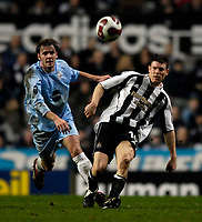 Photo: Jed Wee/Sportsbeat Images.<br /> Newcastle United v Zulte-Waregem. UEFA Cup, 2nd Leg. 22/02/2007.<br /> <br /> Newcastle's James Milner (R) battles with Zulte's Wouter Vandendriessche for the ball.
