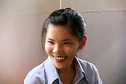 Vietnam, Mekong River Delta Portrait of a young Vietnamese woman