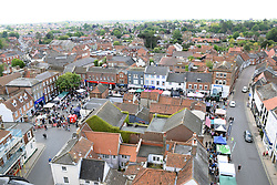 Beccles Food & Drink Festival, May 2019, Suffolk UK. Stokes stall. View of the festival from the top of St Michael's church