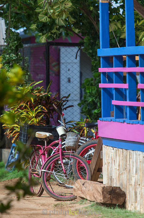 View of a group of bicycles near a colorful balustrade, Little Corn Island, Nicaragua